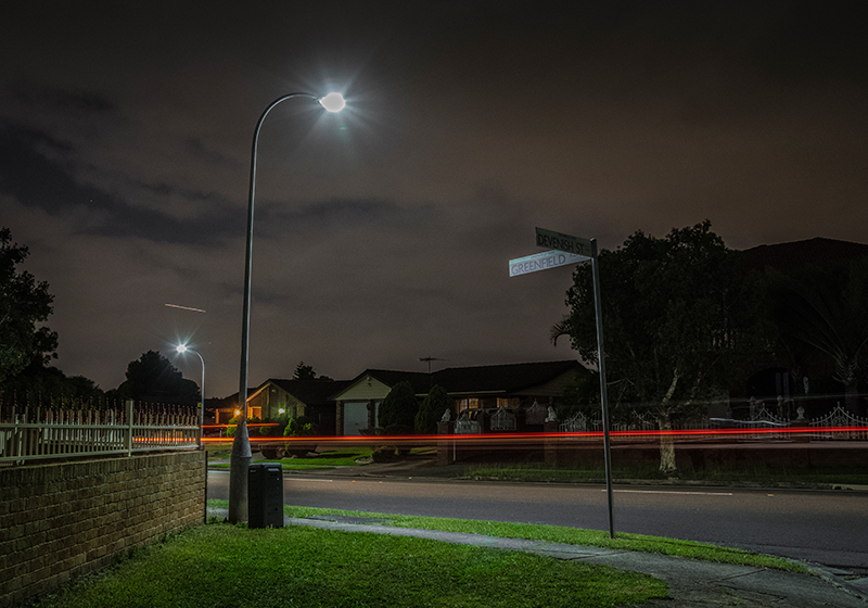 LED street light in Prairewood, Fairfield LGA, with car trail lights streaking by the middle of the shot