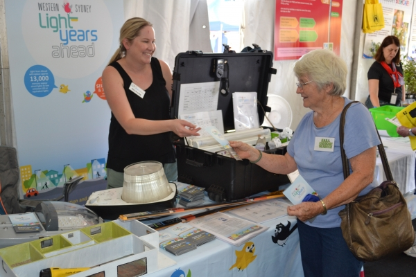 Light Years Ahead Project Manager, Michelle Playford with resident at the Hawkesbury Show.