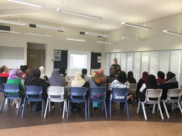 Waste education officer speaking to a Dari community group as part of Cumberland's CALD waste education program.