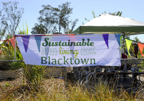 Sustainable Living Blacktown banner at local event.