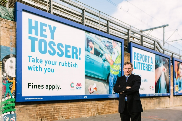 WSROC President Cr Stephen Bali in front of 'Hey Tosser' campaign billboard.